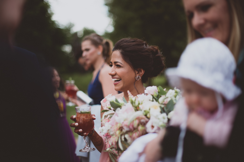 bride laughing with guests - Asian Wedding Photography - candid wedding photography