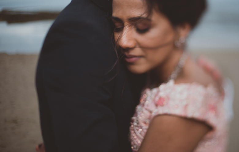 bride and groom hugging - Western Asian Wedding Photography