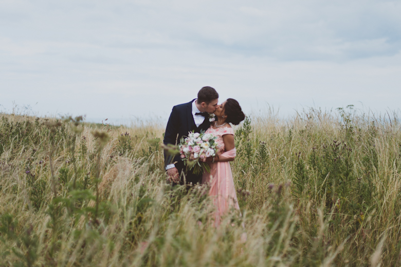 kiss in the bush - Western Asian Wedding Photography - Northumberland coast wedding