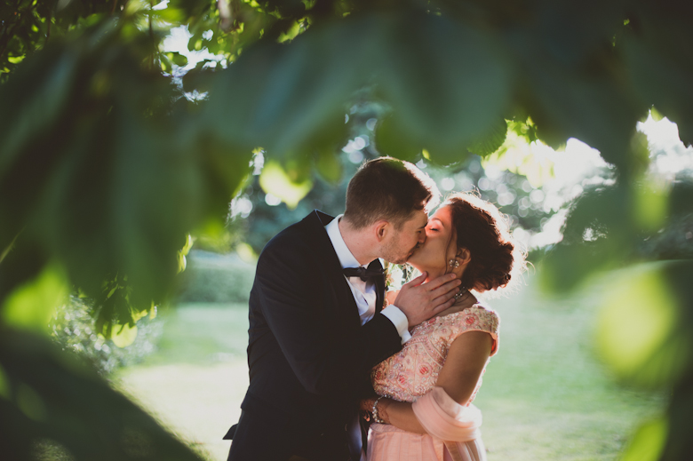 bride and groom kissing - alternative wedding photographer - Western Asian Wedding Photography
