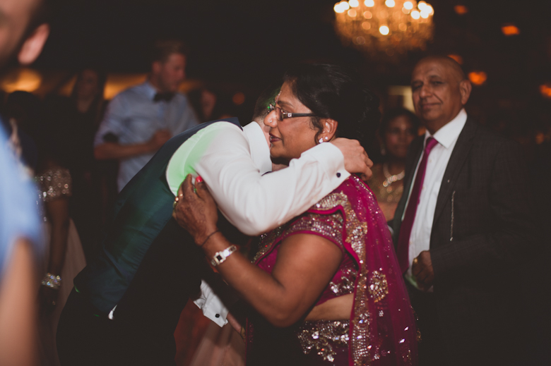 groom hugging mother in law - Asian Wedding Photography