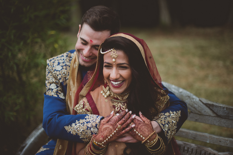 bride and groom laughing Western Asian Wedding Photography