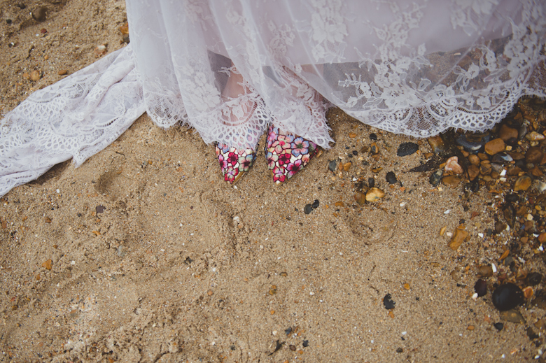wedding shoes on the beach