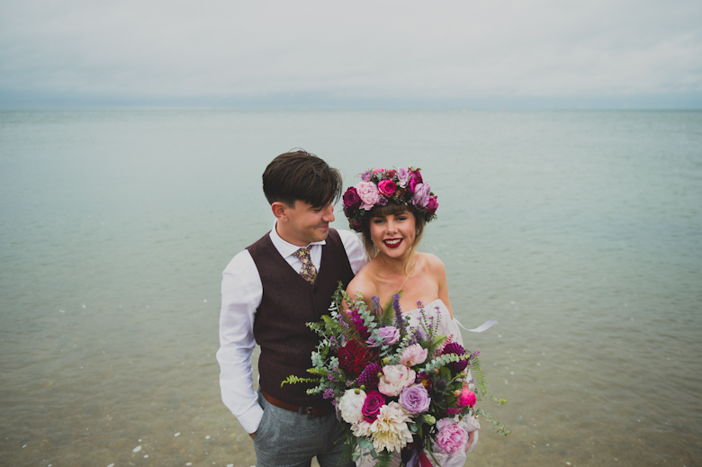 bride and groom in the sea