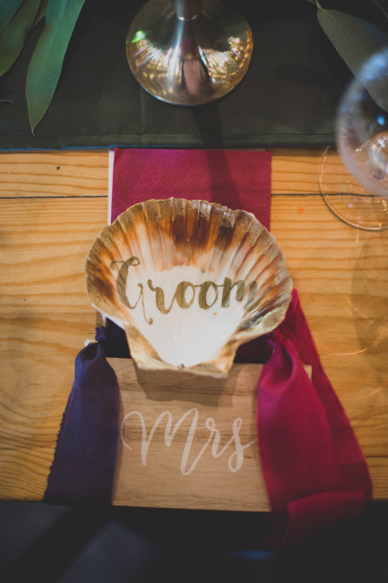 table decor out of oyster shells - festival wedding decor
