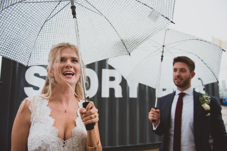 Trinity Buoy Wharf wedding rainy day umbrellas