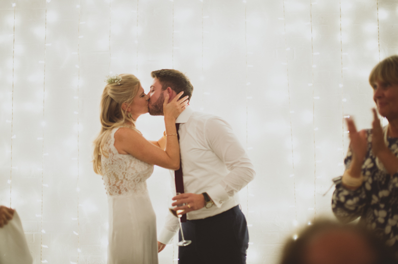 Bride and groom kiss speeches