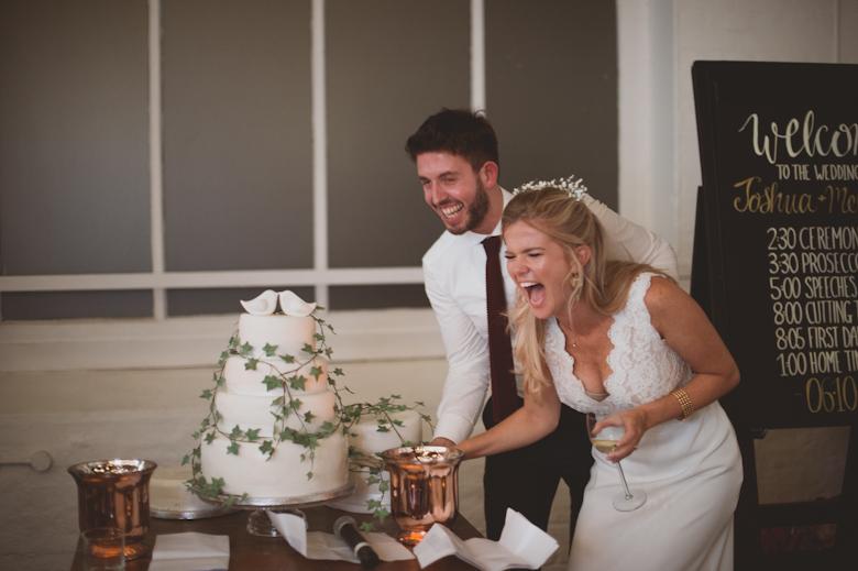 cutting cake fun the trinity buoy wharf wedding