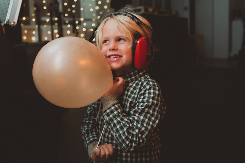 little boy with headphones dancing the trinity buoy wharf wedding