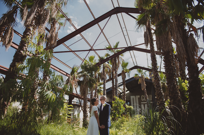 Trinity Buoy Wharf - london wedding venue, palm trees surround bride and groom