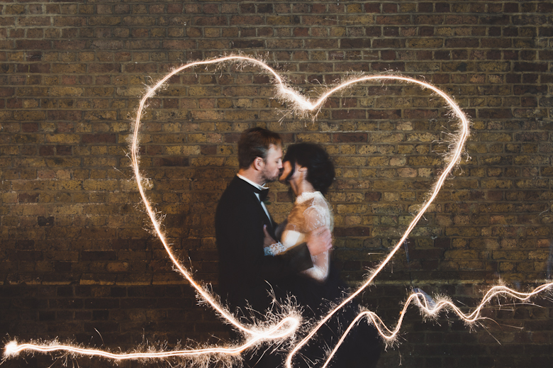 Brixton East - London wedding venue - sparklers heart shape, bride and groom kissing