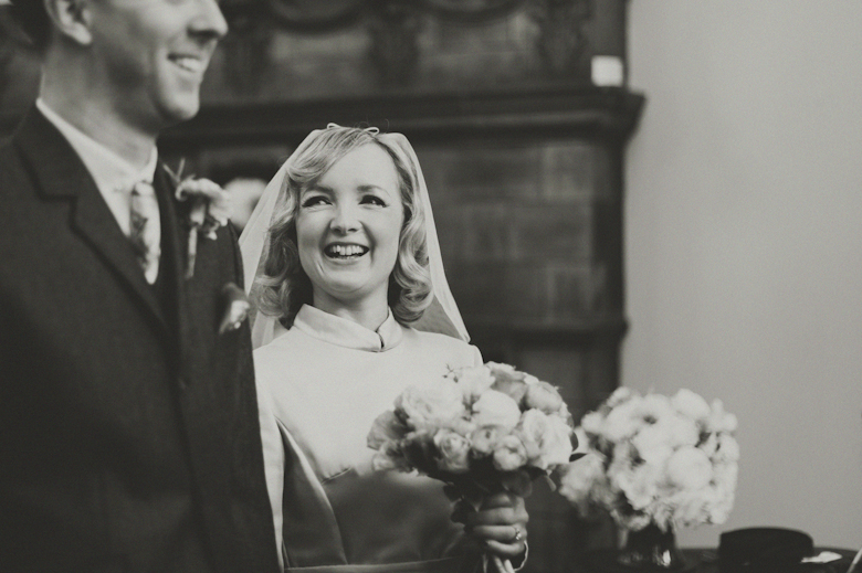 bride and groom laugh at the ceremony
