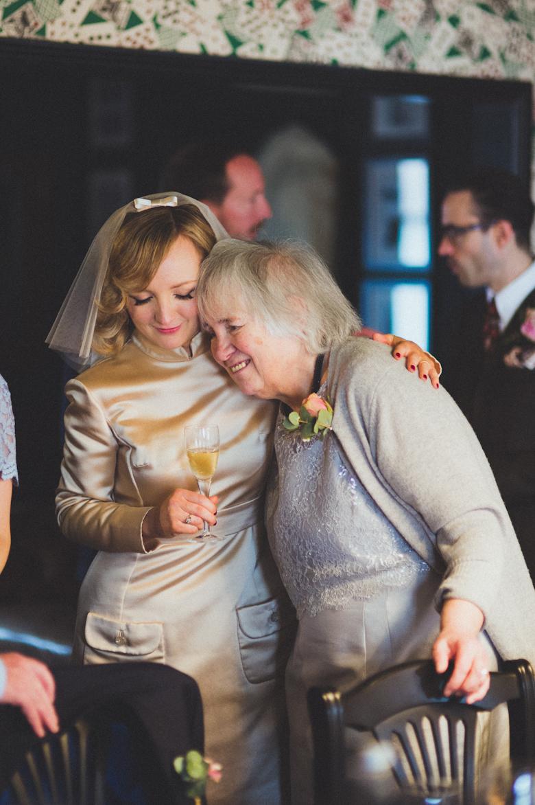 bride and mum hug