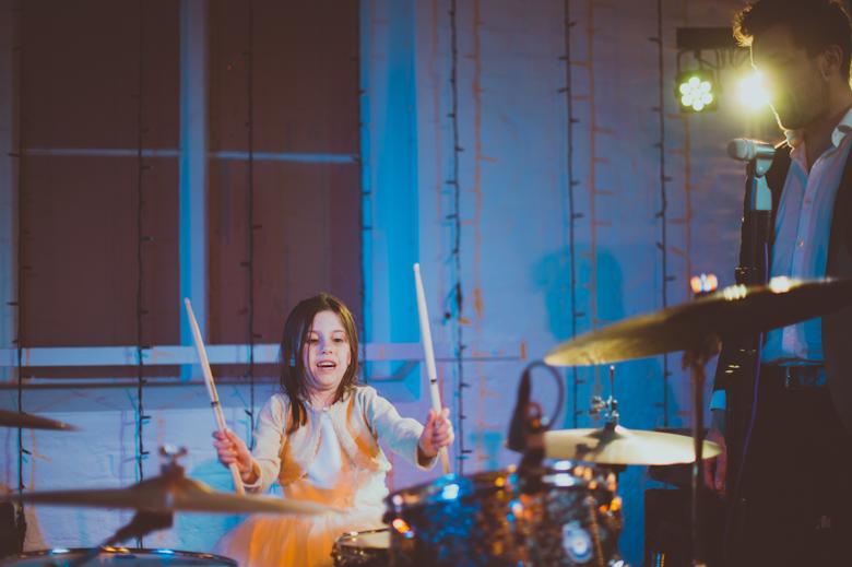 little girl drumming