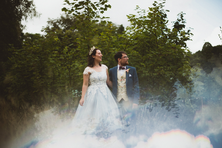 bride and groom in the woodland