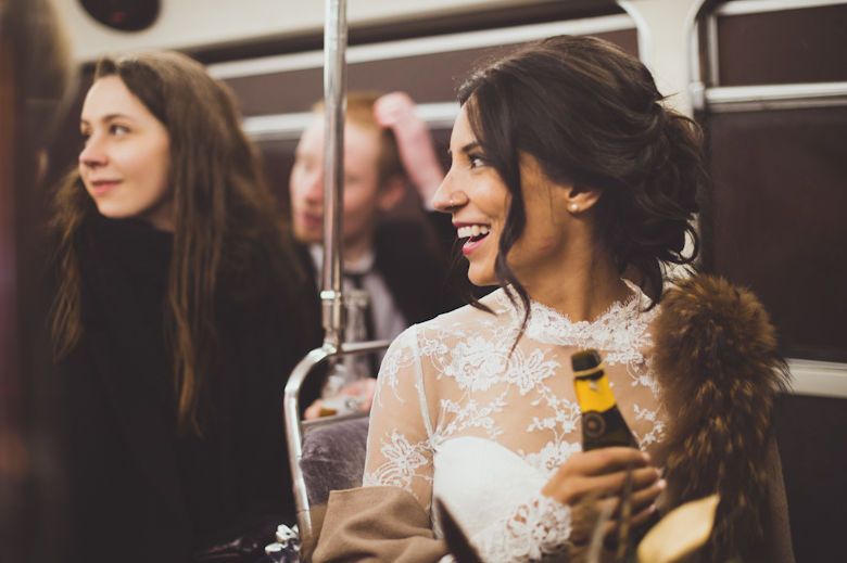 bride laughing on the bus