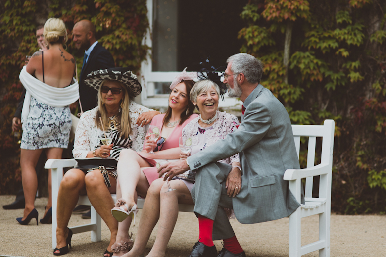 guests laughing, Festival Wedding, outdoor festival wedding, Knighton House, Dorset