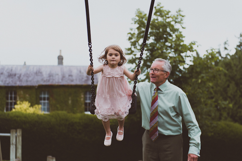 grandad and grandchild playing - Festival Wedding