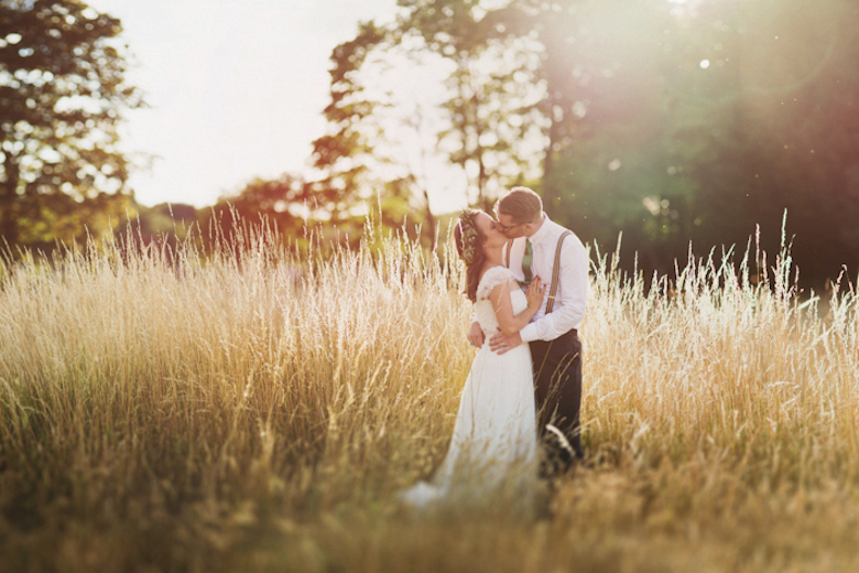 bride and groom in the fields - Surrey wedding photography