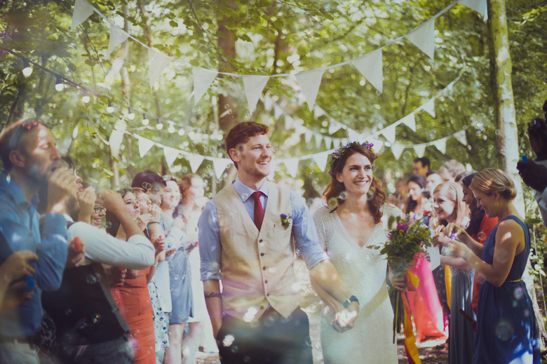 bubbles after the ceremony, happy couple at the Wise Wedding venue, Kent - Woodland Wedding