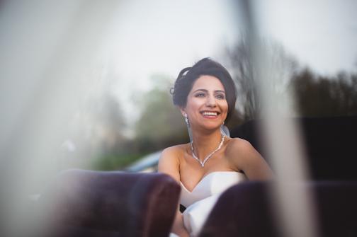 bride in the car - Alternative Wedding Photographer