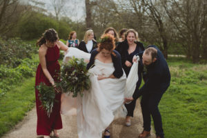 bride, groom, bridesmaids walking