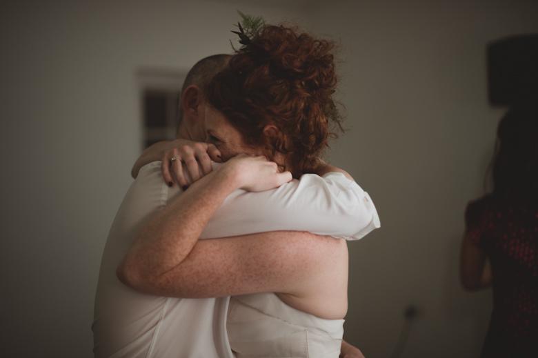 bride and groom dancing huggiing