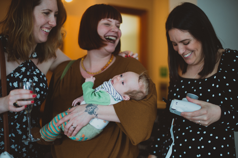 baby and ladies laughing