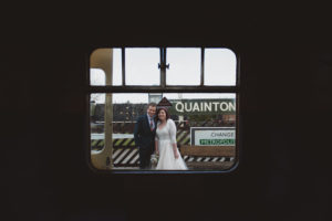 bride and groom outside the train