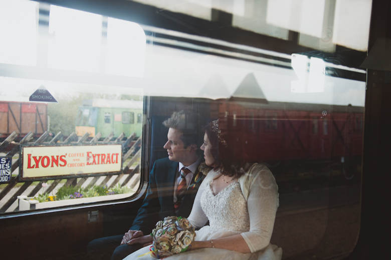 Railway wedding photography - bride and groom on the train