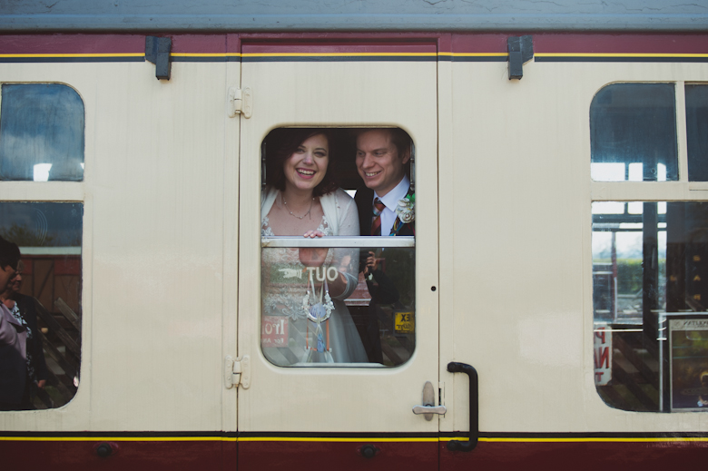 bride and groom in the train's window