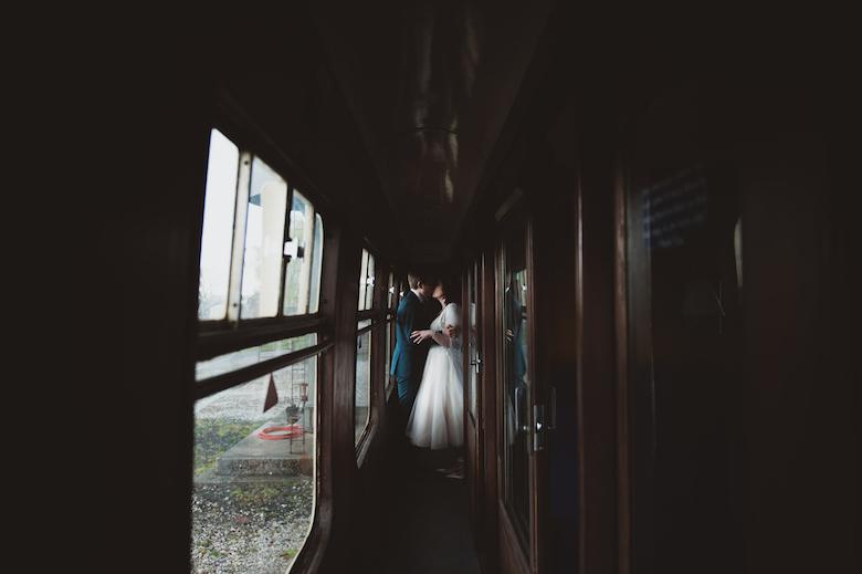 Candid wedding photography - Bride and groom kiss - Buckinghamshire Railway centre wedding