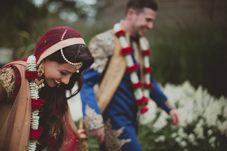 Asian wedding photography - bride and groom walking together - Candid wedding photography