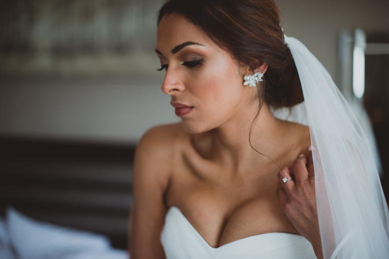 bride in the moment, in a deep though, beautiful shot - Informal wedding photographer - Asylum Peckham wedding
