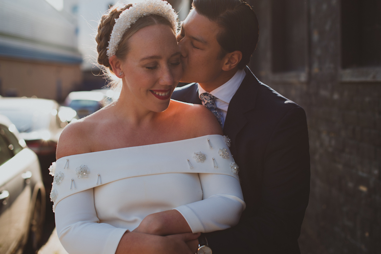 Bride and groom kiss outside the Bistrotheque, East London Wedding
