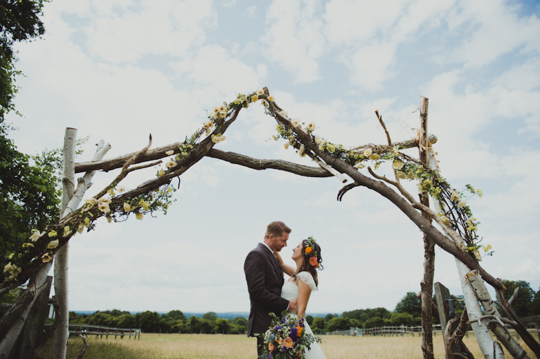 the kiss, outdoor ceremony festival wedding - Surrey wedding photography - festival photographer