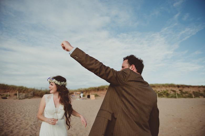 bride and groom on a beach having fun