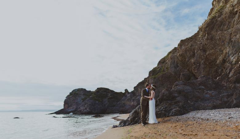 destination wedding photographer - couple on the beach