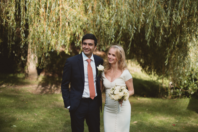 Wedding Photographer Sussex - bride and groom smiling