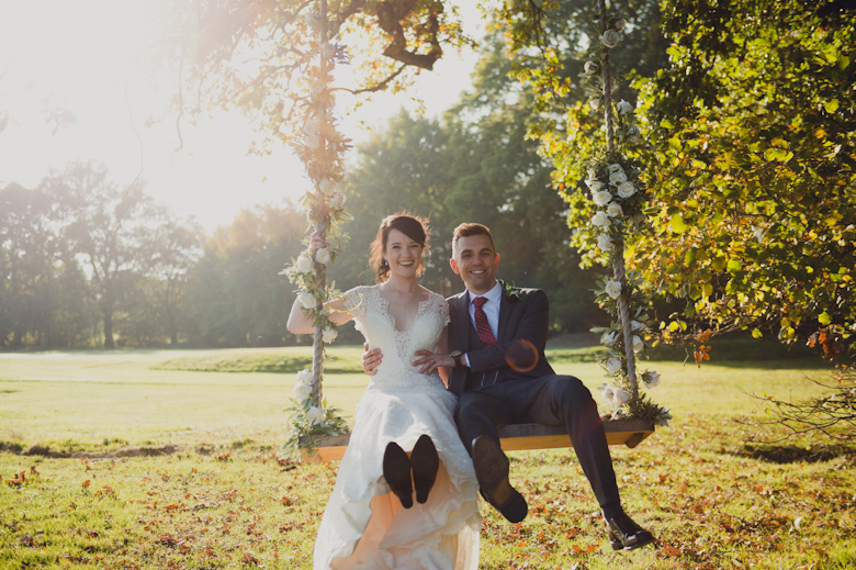 Wedding Photographer Sussex - bride and groom on a swing