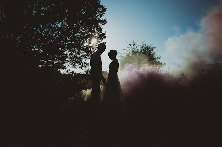 Smoke bombs at sunset time - wedding photo ideas uk - alternative wedding photographer