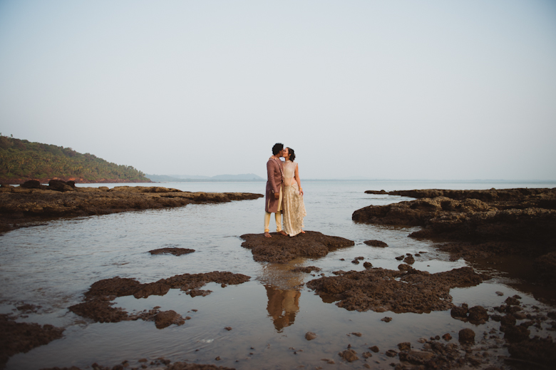 Goa wedding photographer - bride and groom kiss on the beach - natural wedding photography - London wedding photographer