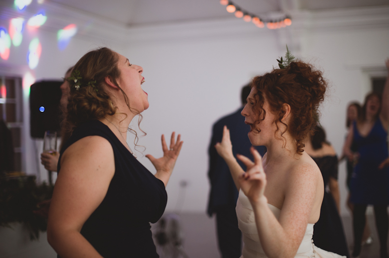 bride and maid of honour dancing singing East London Wedding