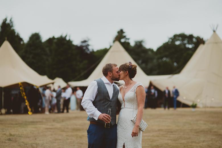 bride and groom kiss Vanstone Park Wedding festival