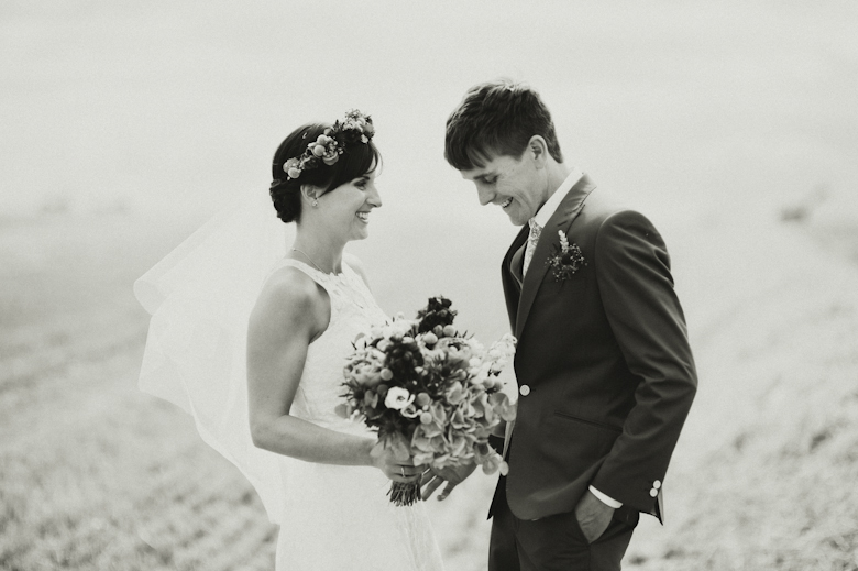 Oxfordshire wedding photographer UK - Bride and groom on a field