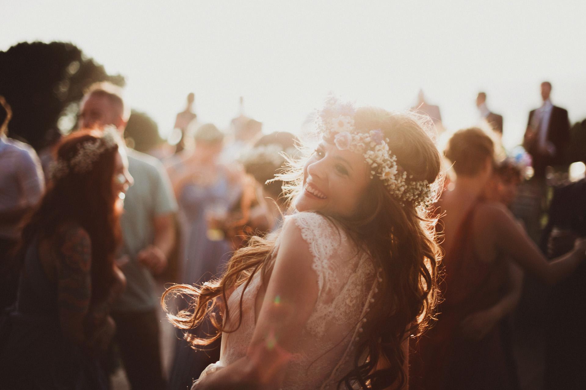 Natural wedding photographer london UK Worldwide - Bride dancing at sunset