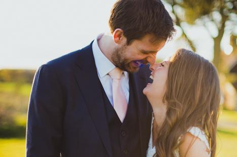 Natural wedding photographer - Barn Wedding Photography - Kent - UK - bride and groom laughing hard - Uk photographer