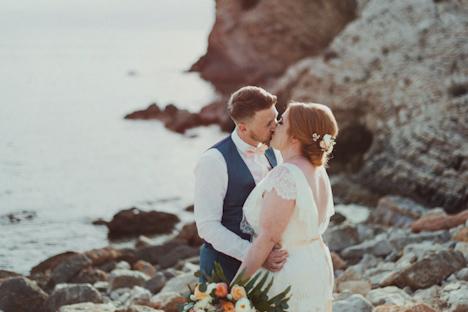 Outdoor Wedding Photography - Ibiza Wedding photography - Elixir venue Ibiza - bride groom kiss on the beach - Beach wedding photography