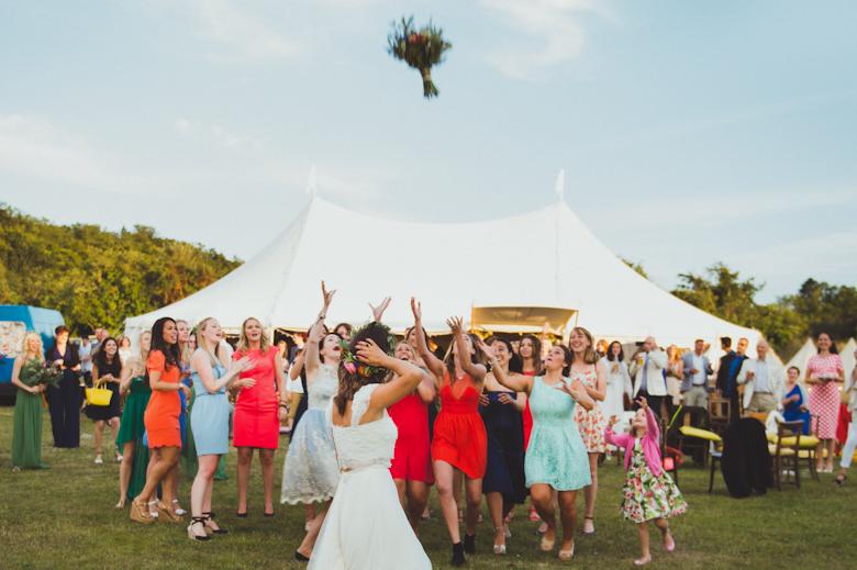 Wedding Photographer Sussex - bride throwing a bouquet