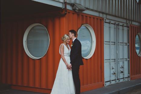London Photographer - warehouse wedding photography London - natural wedding photographer UK - Trinity Buoy Wharf - bride and groom hug